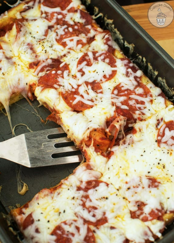 Easy Homemade Pizza has been a family favorite as long as I can remember! It's so easy to make and a sure hit for your family for years to come.