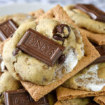 Nothing beats a gooey s'more! These cookies are loaded with all the textures and taste of the classic summertime treat.