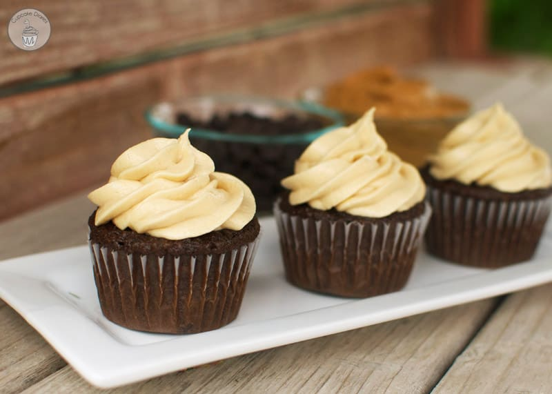 Chocolate Cupcakes with Peanut Butter Frosting - Triple chocolate cupcakes with a perfectly sweet and creamy peanut butter frosting. A classic flavor combo in a fabulous cupcake!