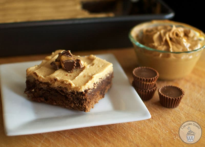 Perfectly moist and chewy chocolate brownies with chunks of peanut butter cups inside, topped with a smooth and creamy peanut butter frosting. Amazing!!