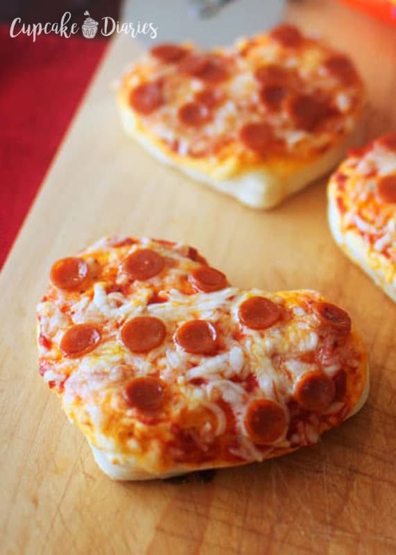 A fun dinner idea for Valentine's Day is Mini Heart Pizzas!