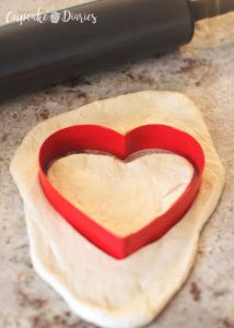 Mini Heart Pizzas - Cut out heart shapes and place on greased cookie sheet