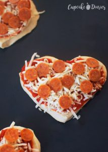 Mini Heart Pizzas - Add pizza sauce, cheese, and toppings to each pizza
