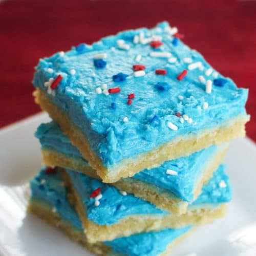 Your Fourth of July dessert table needs these Patriotic Sugar Cookie Bars! This is a perfectly chewy cookie bar that you will want to make all year long.