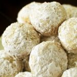 Baked Powdered Sugar Donut Holes - Fluffy donut holes baked to perfection and coated with powdered sugar. This recipe is really easy!
