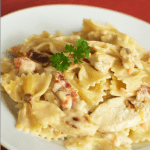 Copycat Johnny Carino's Bowtie Festival features a decadent cream sauce, grilled chicken, and smoked bacon. It's no wonder it's a restaurant favorite!