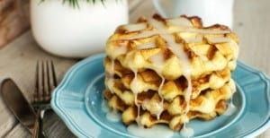 Easy Cinnamon Roll Waffles - You're going to love how easy it is to make these waffles! A fun twist on an ooey gooey cinnamon roll.
