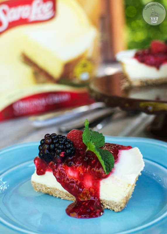 Classic Cream Cheesecake with Mixed Berry Sauce