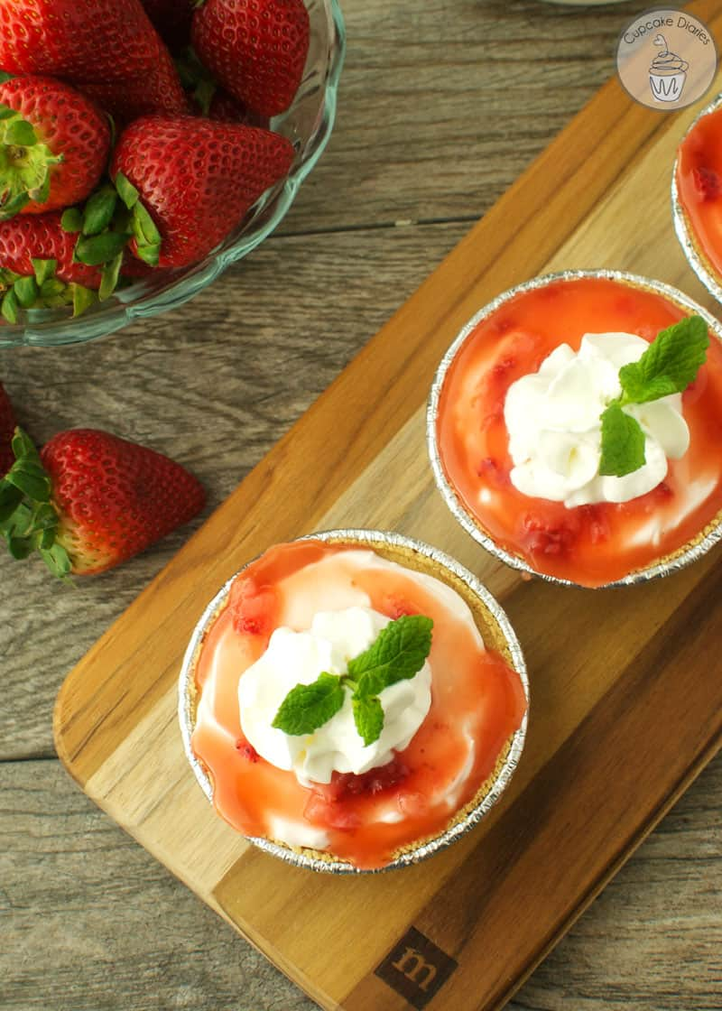 No bake strawberry cheesecakes over mini graham cracker crusts and ...