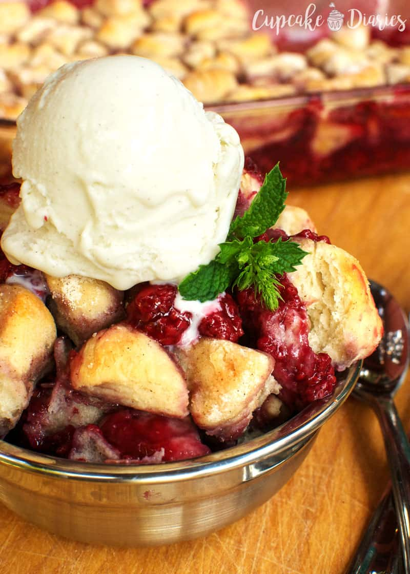 Easy Raspberry Biscuit Cobbler - Top with vanilla ice cream and you've got yourself a delicious treat. This raspberry dessert is perfect for summer!