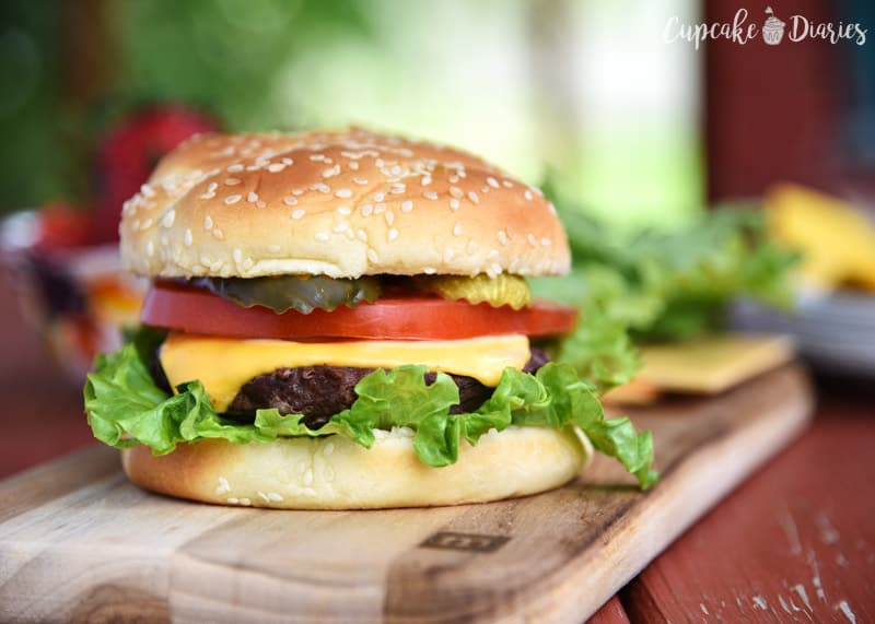 All-American Burger - A juicy beef burger is topped with America's favorite burger toppings! This burger is going to be at a lot of BBQ's this summer.