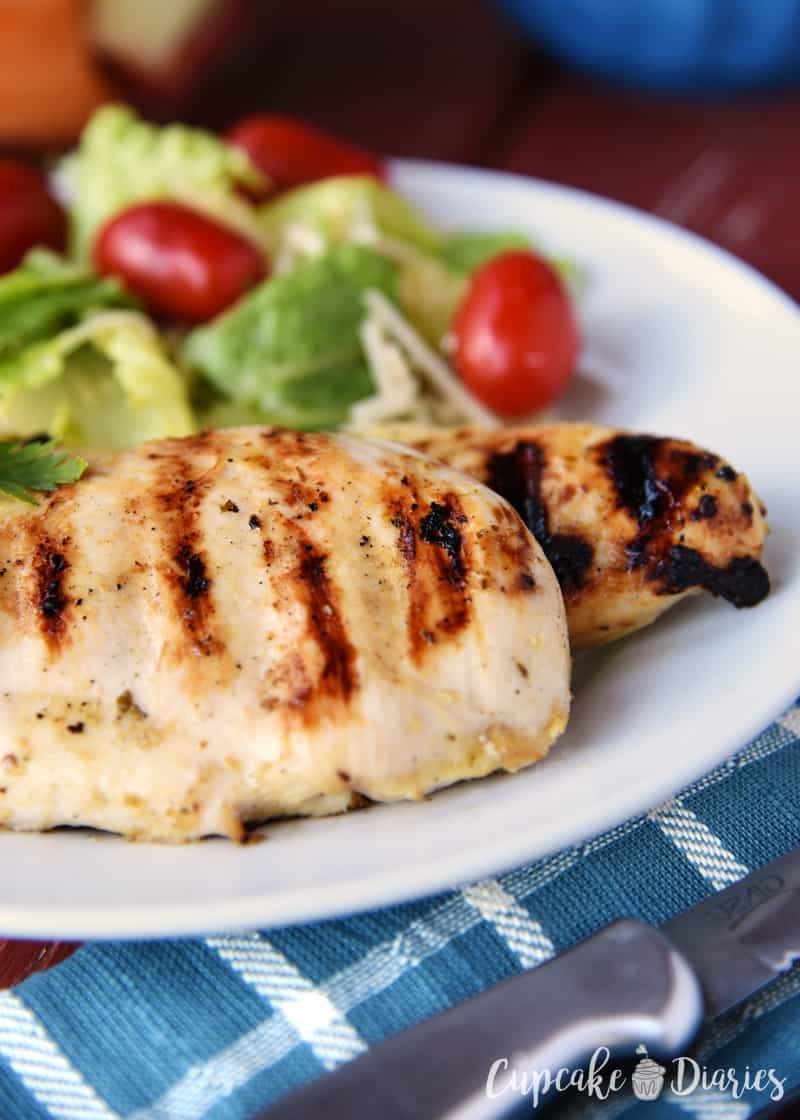 Sweet and Spicy Grilled Chicken - Grilled and juicy chicken breasts are marinated in a two-ingredient dressing to make a perfectly sweet, zesty, and spicy entree!