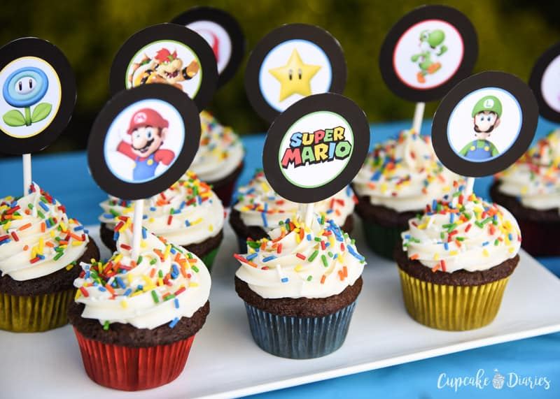 These super cute and free Super Mario Bros. cupcake toppers are the perfect addition to a Mario birthday party!