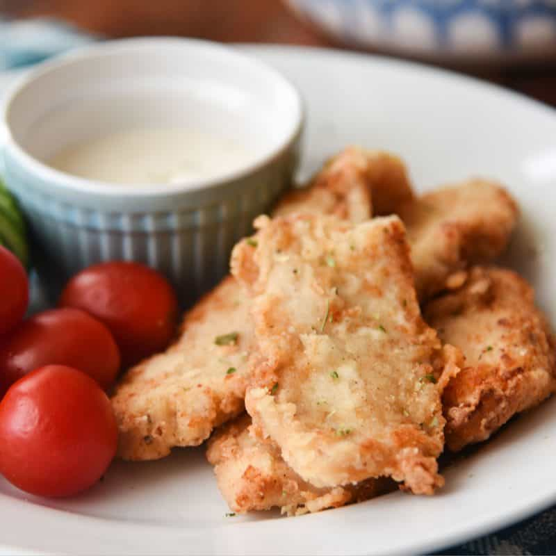 Homemade Low-Carb Chicken Tenders are easy to make and deliciously crispy. Your family will love this healthier spin on a classic!