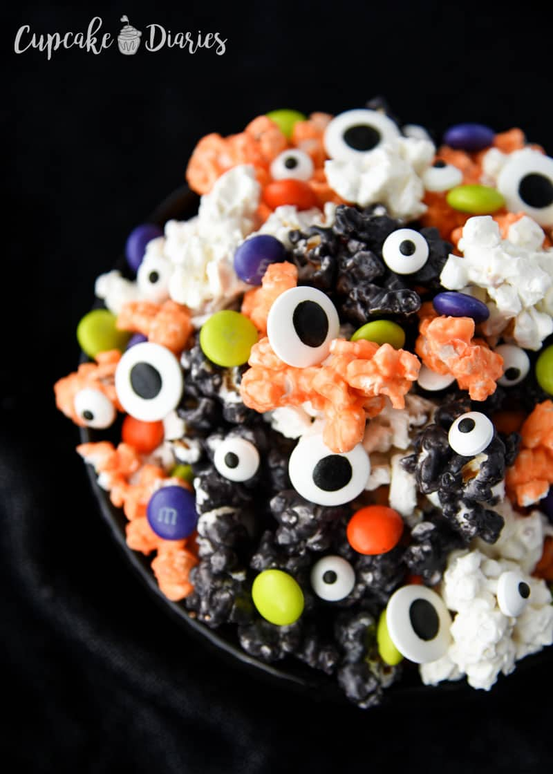 Colorful White Chocolate Halloween Popcorn - Kids and adults will love this sweet and festive treat!