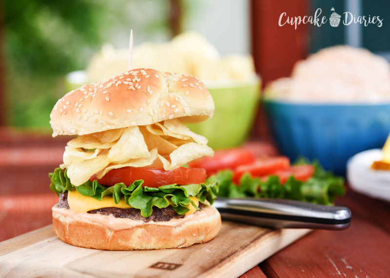 A juicy beef burger piled high with potato chips and classic burger goodness! Don't forget the fry sauce!