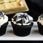 Black and White Spider Web Cupcakes are so fun to make and they're so creepy for a Halloween party! Dark chocolate cake combines with marshmallow buttercream for these spooky treats.