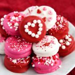 Homemade Dipped Oreos for Valentine's Day are so bright, fun, and easy to make! Package them up in cellophane bags for a simple and tasty valentine gift.