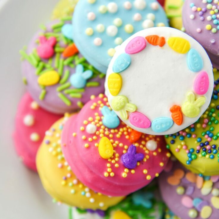 Oreo cookies dipped in bright colors and decorated for Easter!